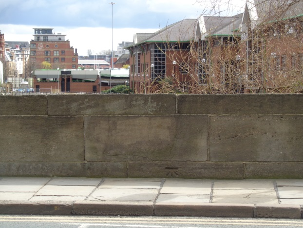 Location view (looking down river) of the old Bench Mark on Victoria Bridge, Leeds (taken April 7 2016).